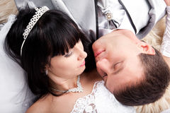 Newly married couple lying together Stock Photos
