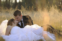 Newly married couple in natural outdoor environment Royalty Free Stock Images