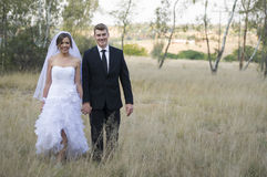Newly married couple in natural outdoor environment Stock Image