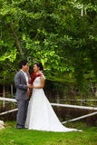 Newly married couple in the park Royalty Free Stock Photo