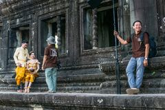 Newly married couple on photoshooting in front of Angkor Wat. SIEM REAP, CAMBODIA - December 29th 2017: Newly married couple on photoshooting in front of Angkor Stock Image