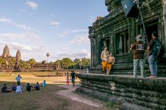 Newly married couple on photoshooting in front of Angkor Wat. SIEM REAP, CAMBODIA - December 29th 2017: Newly married couple on photoshooting in front of Angkor Stock Photo