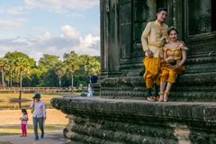 Newly married couple on photoshooting in front of Angkor Wat. SIEM REAP, CAMBODIA - December 29th 2017: Newly married couple on photoshooting in front of Angkor Royalty Free Stock Photography