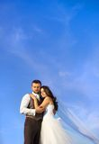 Newly married couple portrait with blue sky Royalty Free Stock Image