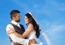 Newly married couple portrait with blue sky Stock Image