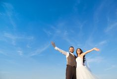 Newly married couple portrait with blue sky Royalty Free Stock Photography
