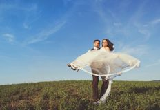 Newly married couple portrait with blue sky Stock Photography