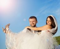 Newly married couple portrait with blue sky Royalty Free Stock Images