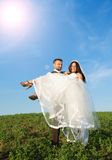 Newly married couple portrait with blue sky Royalty Free Stock Photos
