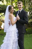 Newly married couple. A newly married couple pose in a garden environment during their official photoshoot stock image