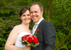 Newly married couple with red roses Royalty Free Stock Photos
