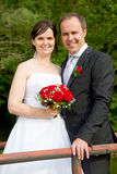 Newly married couple with red roses Royalty Free Stock Images