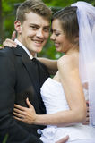 Newly married couple. A newly married couple share a moment during their official photoshoot royalty free stock images