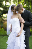 Newly married couple. A newly married couple share a moment during their official photoshoot stock photography