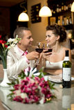 Newly married couple. Sit at table in restaurant with  glass wine,  romance wedding dinner Stock Photo