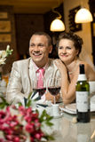 Newly married couple. Sit at table in restaurant,  romance wedding dinner Stock Images
