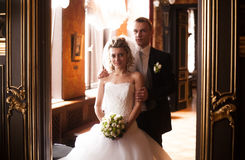 Newly married couple standing in doorway at old palace Stock Image