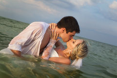 Newly-married couple swimming in sea Royalty Free Stock Photography