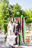 Newly married couple under wedding arch. Young newly married couple under wedding arch Royalty Free Stock Images