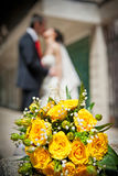 Newly-married couple and wedding bouquet Stock Image
