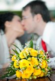 Newly-married couple and wedding bouquet in the fo Royalty Free Stock Photo