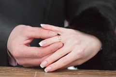 Newly-married couple on wedding dresses gold rings Stock Photos
