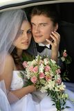 Newly Married Couple in wedding limo. A close up portrait of a newly married bride and groom pictured smiling in their wedding car limousine Royalty Free Stock Photos