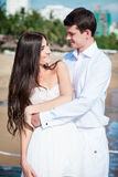 Newly married couple after wedding in luxury resort. Romantic bride and groom relaxing near sea. Honeymoon. Stock Photography