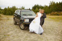Newly married go to a honeymoon trip by car Stock Photography