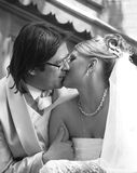 Newly married pair. The groom and the bride kiss in park Stock Photo