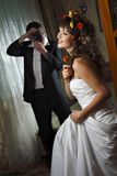 Newly married taking a photograph Royalty Free Stock Photos