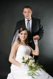 Newly married together in studio. Newly married together in a photo pose Royalty Free Stock Photography