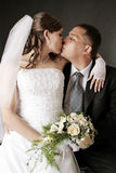 Newly married together in a studio. Newly married together in a photo pose Stock Images