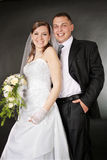 Newly married together in a studio. Newly married together in a photo pose Royalty Free Stock Image