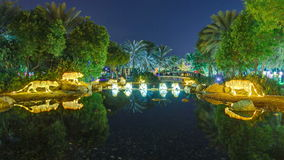 Newly opened Dubai Glow Garden timelapse is a state of Art architecture featuring environment friendly architecture. Lake with tigers and trees. Newly opened stock video footage