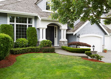 Newly Painted And Stained Exterior Of Modern Home During Summertime Royalty Free Stock Image