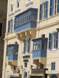 Newly Painted Blue Traditional Maltese Balconies. A style of bacony introduced to Malta by the Portugese has become synonomous with Maltese streets and Royalty Free Stock Photos