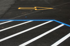 Newly Painted Traffic and Parking Lines. Don't park here, go there! Fresh lines on car park area royalty free stock image