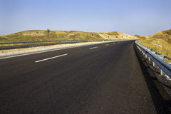Newly Paved Road through Rolling Golden Hills Stock Photography