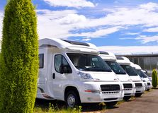 Newly produced motorhomes on a car park in a vehicle factory. Car sales stock photo