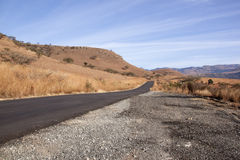 Newly Refurbished Asphalt Road Leading Through Winter Landscape Stock Photos