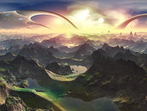 Newly Terraformed World. As the suns rise, their gentle rays illuminate a million breathtaking valleys and mountains stretching out to the glorious sky Royalty Free Stock Images