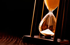 Newly turned hourglass with running sand Royalty Free Stock Images