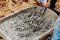 Newly upgraded in laying gray concrete paving. Construction of a concrete in laying gray concrete paving royalty free stock image