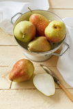 Newly washed pears on the kitchen table Royalty Free Stock Images