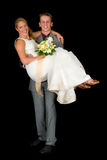 Newly wed couple. Young attractive newly wed couple. Black background, studio shot royalty free stock photography