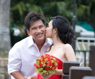 Newly wed couple 8. Newly wed adorable asian couple kissing Royalty Free Stock Photography