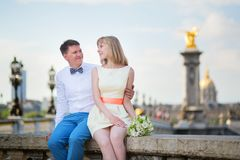 Newly-wed couple on Alexandre III bridge in Paris Royalty Free Stock Photos