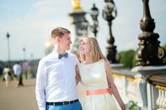 Newly-wed couple on Alexandre III bridge in Paris Stock Photography