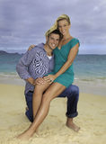 Newly wed couple on the beach Stock Photo
